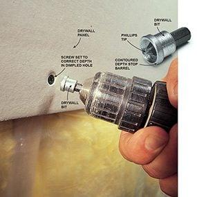 Using a drywall-screw drill-bit attachment.