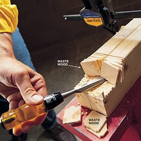 Chisel out the notches in the back legs of the wood work bench.