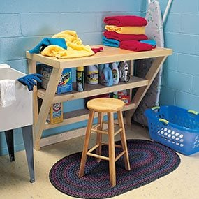 Sand and finish the top of the wood work bench to make a laundry room table.
