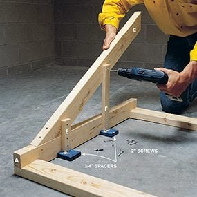 Add the shelf supports to the diagonal braces of the wood work bench.
