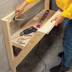 Fasten the wood work bench to the wall.