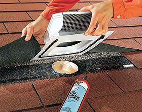 Cut a hole and pull back the shingles when you vent an exhaust fan through the roof.