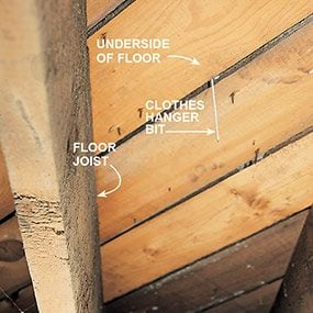 Find the floor outlet location on the underside of the floor.