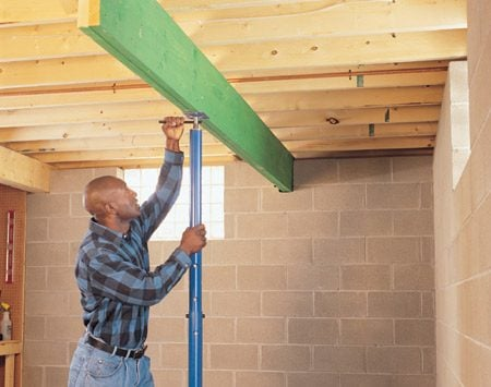 <b>Solution C: Add a wall or beam</b></br> Build a wall or place a beam under the joists.