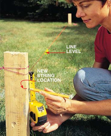 <b>Photo 2: Establish a slight slope</b></br> Tie a stringline to stakes driven at each end of the patio so it stretches in the best drainage direction. Use a line level to adjust the string until it's level. Then lower one end of the string 1 in. for every 10 ft. of length to establish a sloped reference line.