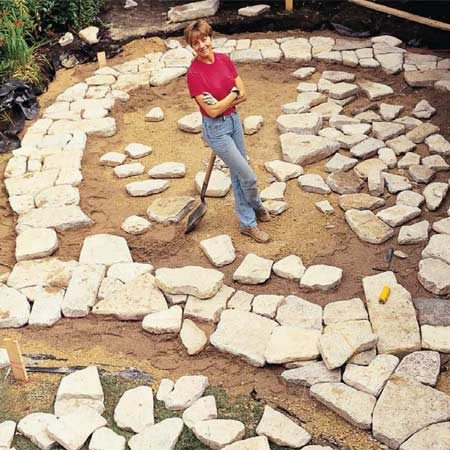 Build a stone patio or brick patio the family handyman for How to build a river rock patio