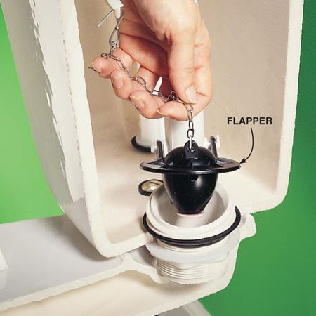 <b>Close-up of Photo 2</b></br> Lift the flapper slightly to release a little water.
