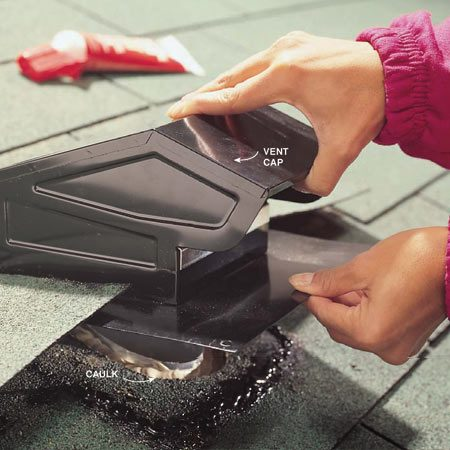 <b>Photo 12: Slide on the vent cap</b></br> Slide the new vent cap under the shingles for a proper fit. Pull it out. Apply roofing cement to the shingles where the top and side flanges will rest. Nail in place.
