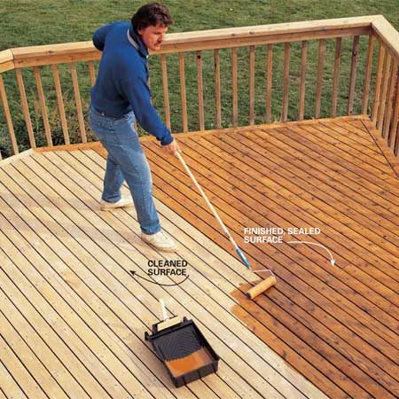 <b>Photo 9: Seal the deck</b></br> Roll on your decking sealer with a roller. We used a clear finish with just a bit of amber tone to warm the color of the decking. If you have tightly spaced deck boards, use a brush to get between them (a couple of boards at a time) as you roll.