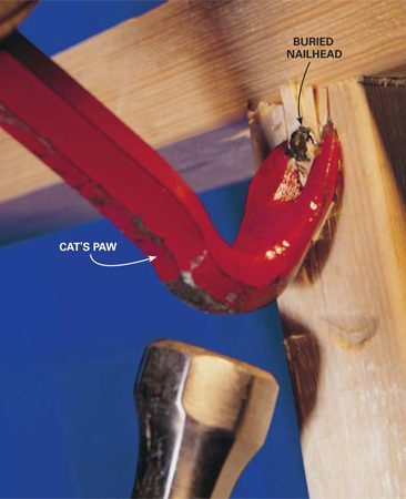 <b>Photo 3: Use a cat's paw</b></br> Drive the claw of a cat's paw under the nailhead and lever it out. A cat's paw can even reach buried nailheads.