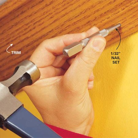 <b>Photo 4: Drive it through</b></br> Punch finish nails all the way through with a nail set or pin punch so you don't have to pull them. This technique works best on finish trim that's less than 5/8 in. thick.