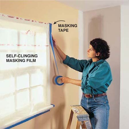 <b>Photo 1: Mask off everything you don't want textured </b></br> <strong>Mask</strong> your windows and doors with plastic sheeting. Then cover remaining trim, outlets and light fixture bases (remove glass covers) with masking tape. Cover your floors with a heavy canvas or multiple layers of those bed sheets you haven't had the heart to get rid of. Don't use plastic sheeting on the floor or your work area will become a skating rink.
