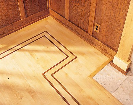 <b>Border detail</b></br> This solid maple floor includes a border made from two strips of Brazilian cherry and a strip of maple.