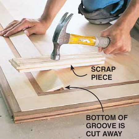 <b>Photo 13: Cut the last piece to fit</b></br> Infill the last piece of flooring by using a table saw to cut off the bottom of the groove so you can slip it by the tongue on the last piece. (Sometimes you'll have to cut off the tongues on boards to drop them in.) You must face-nail the last fill-in pieces.
