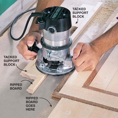 <b>Photo 15: Rout new grooves</b></br> Rout grooves in ripped boards and slide in a slip tongue to join to grooved flooring. If you don't have a router or bit, face-nail the unjoined side to the plywood subfloor.