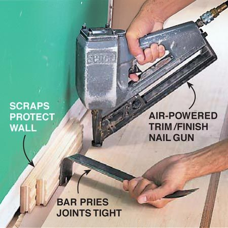 <b>Photo 17: Pry joints tight</b></br> Tighten joints near walls by prying sideways while face nailing to keep joints tight.