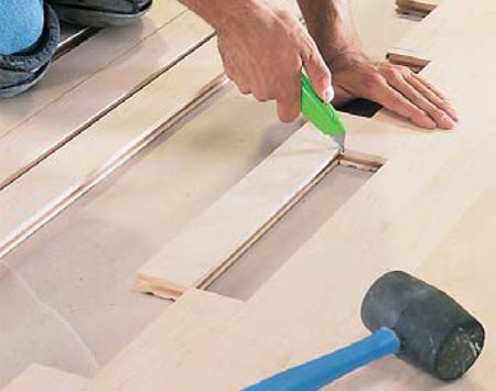 <b>Photo 19: Mark and cut row ends</b></br> Mark the last floor board in each row for length and cut off the <em>tongue</em> end. Randomly stagger unjoined ends in each succeeding row.