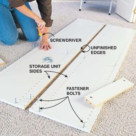 <b>Photo 3: Screw in the fastener bolts</b></br> Lay the sides of the first storage unit on a carpet or dropcloth with unfinished edges together. Screw fastener bolts for the fixed shelves and cleats into the predrilled holes. Your instruction sheet will show which holes to use.