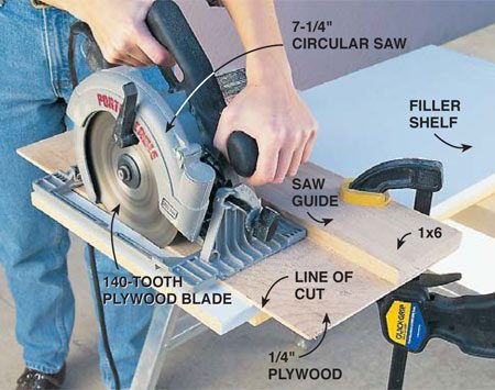 <b>Photo 9: Use a plywood blade to cut the shelf</b></br> Cut the filler shelf with a 140-tooth plywood blade in a circular saw. Clamp a cutting guide so it just covers the line, and run the saw against it to provide a straight cut with a minimal amount of chipping. Construct the cutting guide by screwing a straight 1x6 to an oversized piece of 1/4-in. plywood. Run the saw against the 1x6 fence to cut the plywood at the exact blade location.