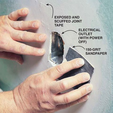 <b>Photo 5: Sand with a light touch</b></br> Control sandpaper with an easy, light touch to avoid scuffing and gouging the surface finish. If your sanding does uncover and then scuff joint tape, apply more mud, feather it out, let the mud dry and carefully sand again.