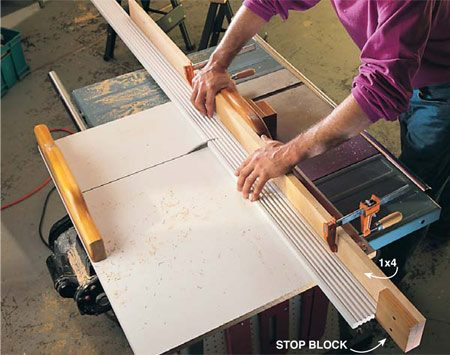 <b>Photo 12: Long repetitive cuts</b></br> <p>Screw a stop block to a 1x4 and screw or clamp the 1x4 to the fence for repetitive, identical cuts that exceed the table saw fence rip capacity.</p> <p><strong>Tip:</strong> Keep the stop blocks 1/8 in. above the sled table so sawdust won't pile up against the block and make your length cuts inaccurate.</p> <p><strong>Caution:</strong> Blade guard is removed for this operation.</p>