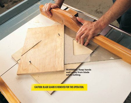 <b>Photo 14: Make a 45 degree angle jig</b></br> <p>Use a 45-degree architectural square to cut a perfect 45-degree, 12-in. long jig from a piece of scrap plywood. Screw the jig stock to a separate piece of plywood held tight against the fence to hold it in place for safe cutting. Screw a 1x2 flush with the back edge of the jig with 1-5/8 in. drywall screws (Photo 15). Hold the right-end screw 3 in. away from the tip of the triangle.</p> <p><strong>Caution:</strong> Blade guard is removed for this operation.</p>