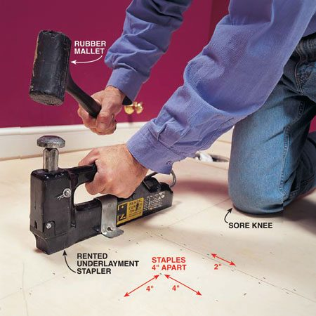 <b>Photo 9: Use a rented stapler</b></br> Staple the underlayment to the bathroom subfloor using a rented underlayment stapler loaded with 7/8-in. staples. Place staples 4 in. apart in the center of the sheet and 2 in. apart along seams and edges.