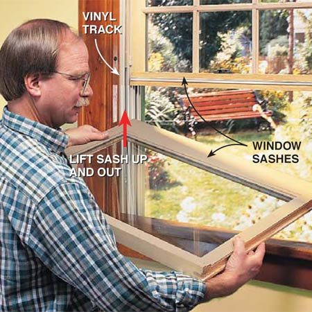 <b>Photo 1: Remove the sash</b></br> Remove the window sash from the vinyl track. The sash has to be low and level before you lift the first side out of the jamb liner.