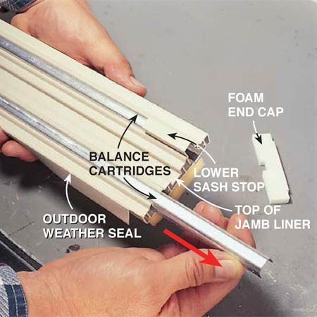 <b>Photo 5: Slide out the bad cartridge</b></br> Study the jamb liner components and how they're put together. Determine which is the top end of the jamb liner and which is the sill end (the angled cut). Remove the foam cap at the top, release the S-clip and slide out the crippled balance cartridge. Remember which balance cartridge came from which channel of the vinyl jamb liner. The cartridge with the shorter S-clip is always installed on the exterior side of the window.