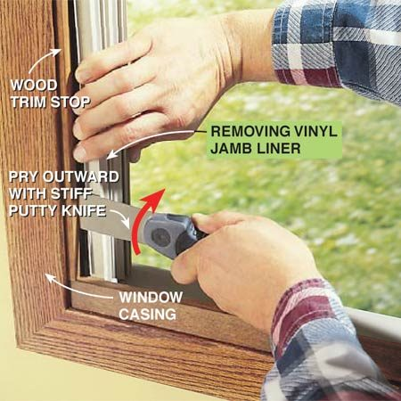 <b>Photo 4: Remove the jamb liner</b></br> Remove this type of vinyl jamb liner by working a stiff putty knife between the window stop and the track. Grab the vinyl edge with one hand, then pry the knife outward to release the jamb liner and avoid damaging the wood stop.