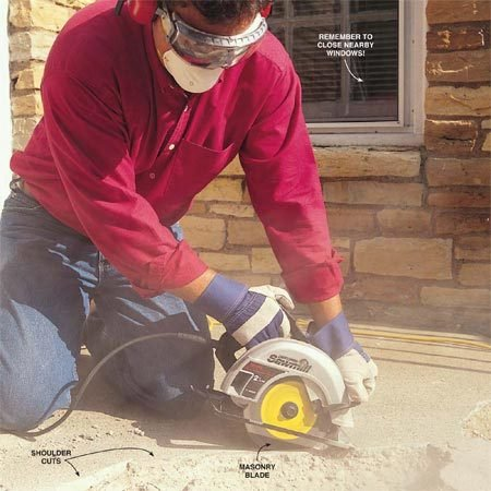 "<b>Photo 1: Cut around the chipped area</b></br> Cut a 3/8-in. to ½-in. deep ""shoulder"" around the edge of the spalled area with a saw and masonry blade. Move the saw slowly as you cut. Make sure you cut back into solid concrete to ensure a strong bonding surface."