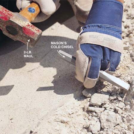 <b>Photo 2: Chisel out weak areas</b></br> Break out all weak and loose concrete with a maul and cold chisel. Sharp concrete chips will come flying out, so wear safety goggles.
