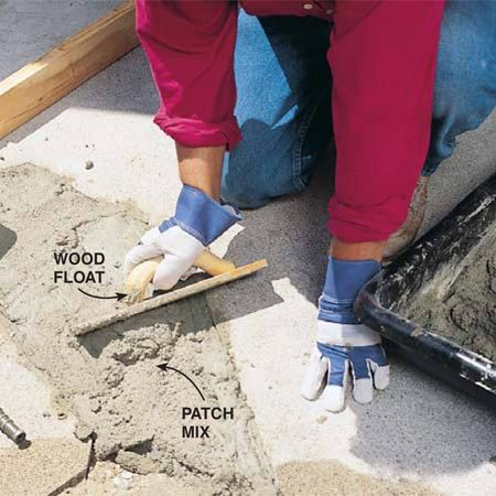 <b>Photo 4: Moisten and fill </b></br> Moisten the patch area with a wet sponge. Then pack in the patch mix with a wood float. Leave the mix slightly higher than the surface of the old concrete.