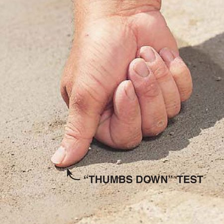 <b>Photo 6: Let the concrete stiffen </b></br> Test the firmness of the patch by lightly pressing your thumb on the surface. When your thumb no longer leaves an indentation, go ahead and finish the surface.