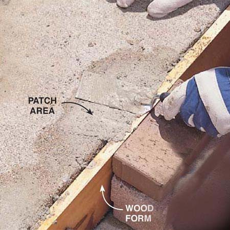 <b>Photo 10: Form the repair and pack in patching mix </b></br> Anchor a form board against the side of the step, moisten the area and pack in the repair mix. Screed off the excess patching material.