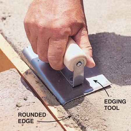 <b>Photo 11: Round the edge </b></br> Slide an edging tool along the step edge to round it. Use the edging tool only if the old step portion has a rounded edge.