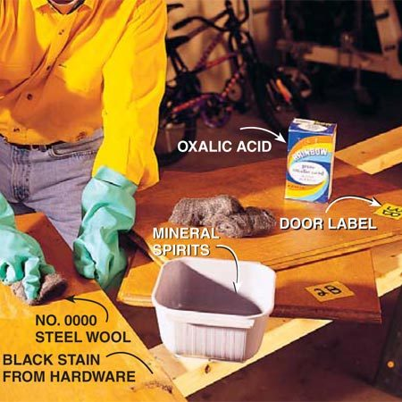<b>Photo 1: Clean the wood</b><br/>Clean the dirty doors, drawer faces and cabinets by lightly rubbing them with mineral spirits and No. 0000 steel wool or synthetic steel wool. Work in a well-ventilated area. Too much rubbing will create lightened areas. If you have stubborn black stains left by hardware, apply oxalic acid (available at hardware stores) with a cotton swab (follow manufacturer&#39;s directions). Rinse off the acid as soon as the stain disappears. If you accidentally lighten an area too much, apply a matching gel stain to the spot and let it dry before proceeding.