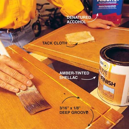 <b>Photo 3: Apply finish</b><br/>Apply two coats of shellac to the routed door face.  Use the wax-free type, or make sure the final topcoat that you use is compatible with regular shellac. Use a tack cloth to clean the doors before the first and between subsequent coats. The shellac acts as a primer because it will bond to any finish on your old doors. Clean the brushes with denatured alcohol. After the shellac dries, apply two coats of water-based polyurethane. Sand lightly between coats.
