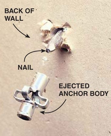 <b>Photo 2: Push the anchor through the wall</b></br> Push the anchor body into the wall cavity with a nail. Repair the wall with patching compound and then paint the spot.