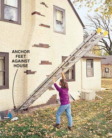 <b>Photo 1: Anchor the ladder</b><br/>Anchor the base and walk the ladder up.