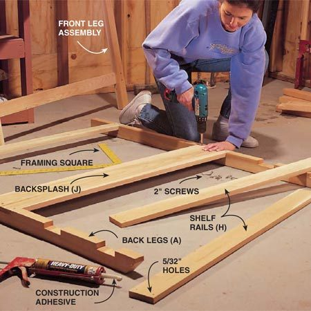 <b>Photo 3: Assemble the leg sections</b></br> Spread a small bead of construction adhesive in each notch and lay the horizontal pieces in place. Use a framing square to make sure the cross members are at right angles to the legs, then drive a pair of 2-in. screws at each joint