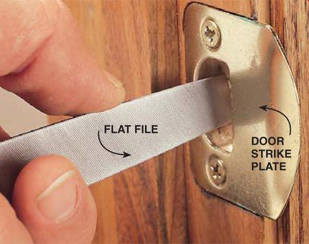 <b>Photo 1: File the strike plate</b><br/>Insert either a triangular file or a flat file that's small enough to fit inside the strike plate. File off enough metal to allow the latch to catch inside the plate and secure the door. If your filing action is shaking the strike plate, remove the plate and secure it in a vise for your repair. Then reinstall the plate with longer screws.