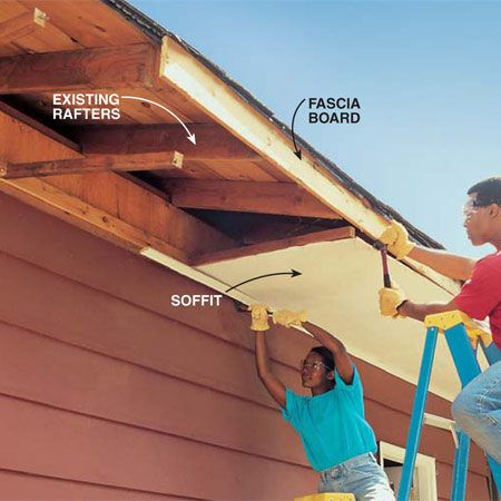 <b>Photo 8: Open up the garage rafters</b></br> Pry off the soffit and fascia material in the area of the shed. Remove full pieces if possible. Then cut and replace them after the shed is built.