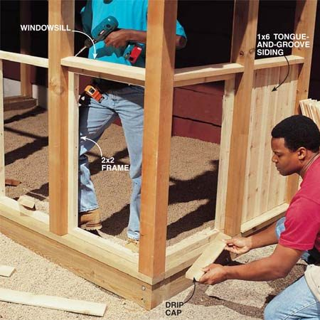 <b>Photo 21: Frame and install siding</b></br> Frame between the posts with 2x2s nailed flush with the inside surface of the 4x4 posts. Cut angled windowsills and drip caps on a table saw to fit between the posts at the top and bottom of each section. Nail the drip cap to the 2x4 bottom plate and screw the windowsill to the 2x2 frame. Fill each section with siding nailed to the 2x2 frame. Drill pilot holes for the nails to keep them from splitting the siding.