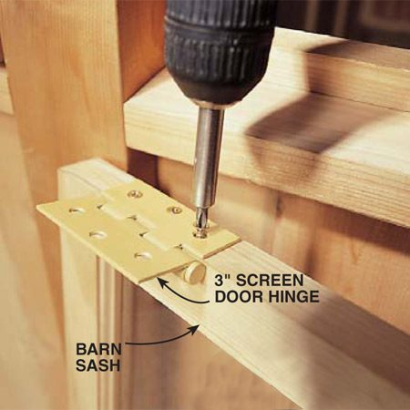 <b>Photo 22: Trim and hinge the windows</b></br> Trim the barn sash to fit in each opening, allowing about 1/8 in. on the sides and bottom and 1/4 in. on the top. Screw a 3-in. screen door hinge to the top of the sash.