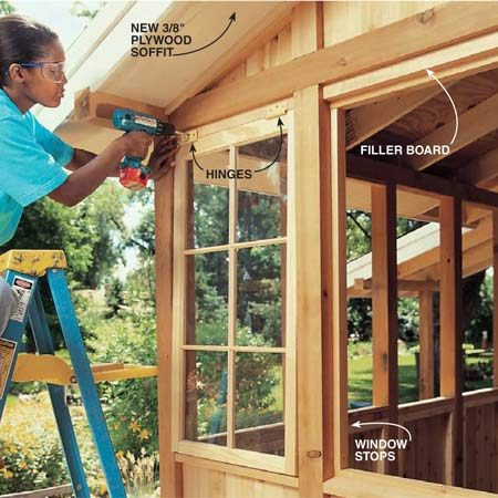<b>Photo 23: Hang the windows</b></br> Screw a 2-5/8 in. x 1-1/2 in. cedar board to the top of each window opening. Screw the hinges to this board. Nail 3/4 in. x 1-1/4 in. cedar stops to the top and bottom of the opening and 1/2 in. x 1-1/4 in. stops to the sides. Position the stops flush with the inside edge of the 4x4.