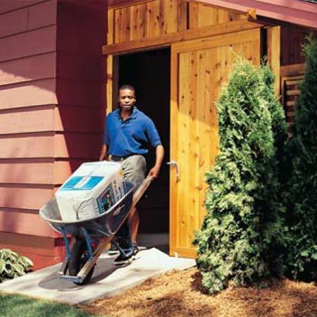 <b>Sliding door access</b></br> The sliding door opens wide enough for wheelbarrows to roll through.