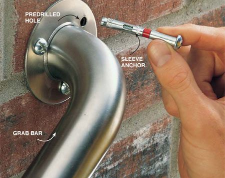 <b>Photo 4: Slide the sleeve into the predrilled hole</b></br> Mount grab bars and railing brackets to soft masonry like brick and concrete block with sleeve anchors. Slide the sleeve into the predrilled holes and tighten.
