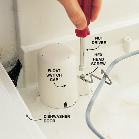 <b>Photo 4: Remove the float switch</b></br> Unscrew the hold-down screw on the float switch and lift the cap straight up and off.