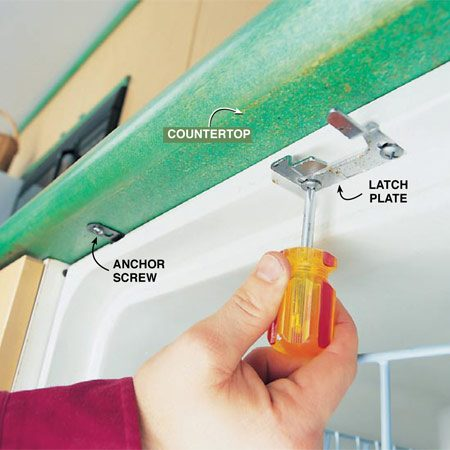 <b>Photo 11: Adjust the latch plate, if needed</b><br/>Loosen the screw of bolt that holds the door latch plate. Shift the latch slightly inward and retighten. Latch the door and test the fit.